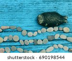 A Wooden Fish And A Sea Waves...