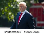 president donald trump walks... | Shutterstock . vector #690212038