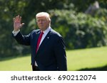president donald trump walks... | Shutterstock . vector #690212074