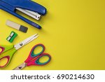 school accessories on a yellow... | Shutterstock . vector #690214630