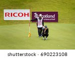 Small photo of Kingsbarns, St Andrews Scotland, 4th August 2017. Anna Nordqvist and her caddie line up a par putt during the second round of the Ricoh Women's British Open