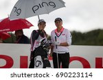 Small photo of Kingsbarns, St Andrews Scotland, 4th August 2017. Canadian Brooke Henderson and caddie discuss tactics during the second round of the Ricoh Women's British Open