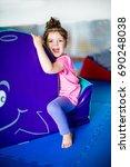 little girl having fun at soft... | Shutterstock . vector #690248038