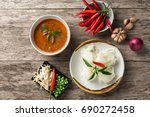 noodle with fish curry sauce... | Shutterstock . vector #690272458