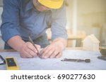 architect or planner working on ... | Shutterstock . vector #690277630