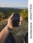 Small photo of Human Arm Showing Altimeter at Castle Rock summit view from the top, sunset, forest hills, seashore view, ocean and islands.