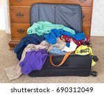 messy packed suitcase of a man... | Shutterstock . vector #690312049