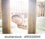 little asian cute boy sleep... | Shutterstock . vector #690320044