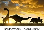 silhouette of dinosaurs in the... | Shutterstock . vector #690333049