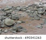 stones of a mountain river | Shutterstock . vector #690341263