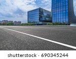 empty asphalt road front of... | Shutterstock . vector #690345244