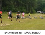 Small photo of Neilsville, Wisconsin, USA. 07/16/2011 Riders rushing to their mountain bikes in La Manse style race.