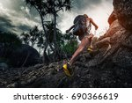 woman hiker with backpack... | Shutterstock . vector #690366619