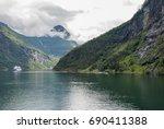 travel norway at geiranger fjord | Shutterstock . vector #690411388