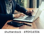 handsome businessman in suit... | Shutterstock . vector #690416506