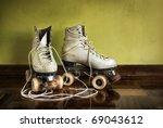 Old Worn Roller Skates With Bi...