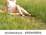 girl in leather sandals sitting ... | Shutterstock . vector #690440896