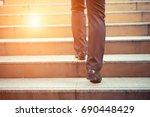 business man going up the... | Shutterstock . vector #690448429