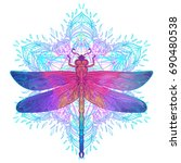 Stock vector ornate dragonfly over colorful round mandala pattern ethnic patterned vector illustration african 690480538