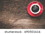 a red cup of coffee morning on...   Shutterstock . vector #690501616