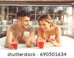 young couple rest togethernear... | Shutterstock . vector #690501634