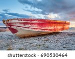 old red boat on beach with... | Shutterstock . vector #690530464