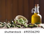 olive oil and olives on wooden... | Shutterstock . vector #690536290