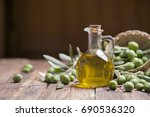 olive oil and olives on wooden... | Shutterstock . vector #690536320