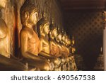 Row Of Golden Buddha Statue At...