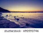 amazing sunrise on the pier at... | Shutterstock . vector #690593746