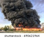 warehouse engulfed in raging...   Shutterstock . vector #690621964