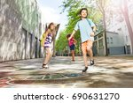 Small photo of Boys and girls play hopscotch in the school yard
