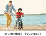 young man teaching his son to... | Shutterstock . vector #690646579