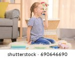 girl using inhaler during... | Shutterstock . vector #690646690