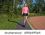 girl riding a kick scooter. | Shutterstock . vector #690649564