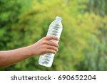 water bottle in human hand... | Shutterstock . vector #690652204