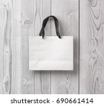 paper bag for shopping on a... | Shutterstock . vector #690661414