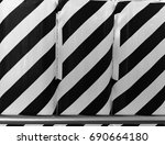 pattern on a row of bottles... | Shutterstock . vector #690664180