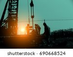 the oil workers at work | Shutterstock . vector #690668524
