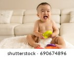 baby playing toys  | Shutterstock . vector #690674896