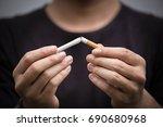 young man crushing cigarette... | Shutterstock . vector #690680968
