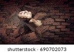 hand breaking through the wall. ... | Shutterstock . vector #690702073