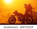 silhouette of biker man with... | Shutterstock . vector #690722239