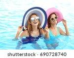 beautiful young women relaxing... | Shutterstock . vector #690728740