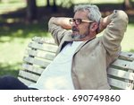 portrait of a pensive mature... | Shutterstock . vector #690749860
