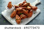 baked chicken wings with sesame ... | Shutterstock . vector #690773473
