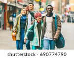 group of young friends walking... | Shutterstock . vector #690774790