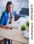 woman sitting on the desk with... | Shutterstock . vector #690786874