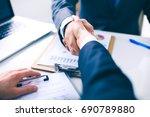 business people shaking hands ...   Shutterstock . vector #690789880