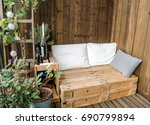 wooden pallet couch on balcony | Shutterstock . vector #690799894